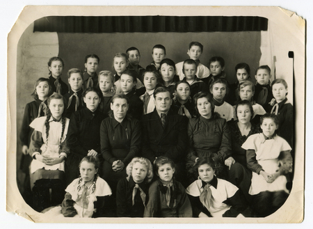 Ussr - CIRCA 1970s: An antique Black & White photo shows group people 新聞圖片