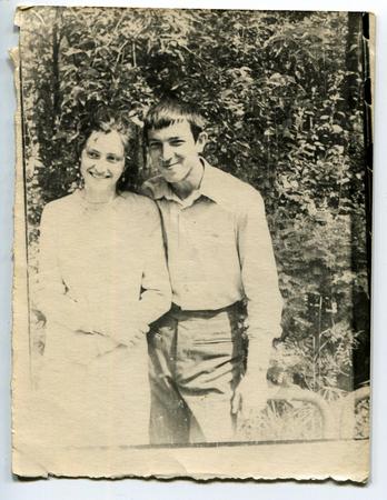 Ussr - CIRCA 1970s: An antique Black & White photo show Boy and girl in the garden