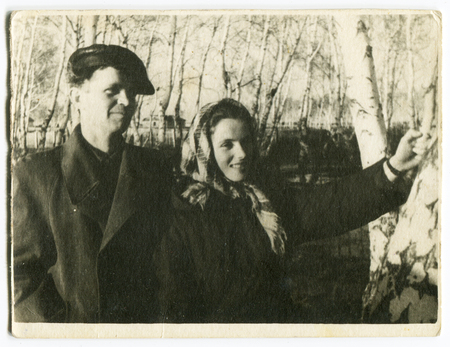 generational: Ussr - CIRCA 1970s: An antique Black & White photo show a young married couple in the woods