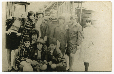 Ussr - CIRCA 1970s: An antique Black & White photo show Group portrait of a group of young people