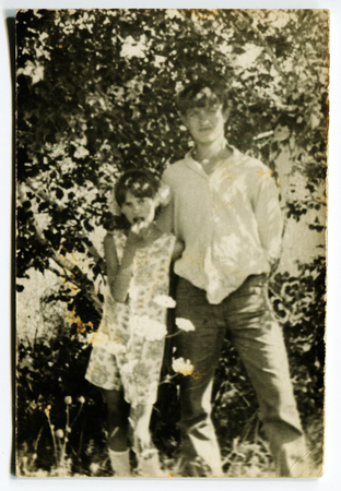 Ussr - CIRCA 1970s: An antique Black & White photo show brother and sister in the garden