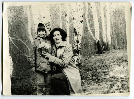 Ussr - CIRCA 1970s: An antique Black & White photo show Mom and daughter in the forest near birch
