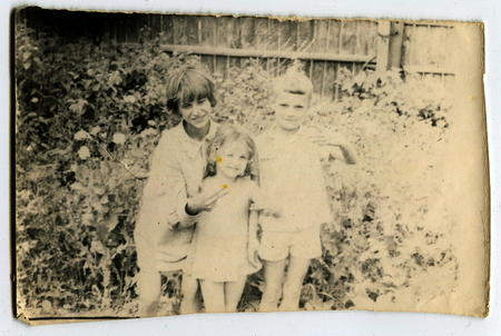 Ussr - CIRCA 1970s: An antique Black & White photo show three children in the garden