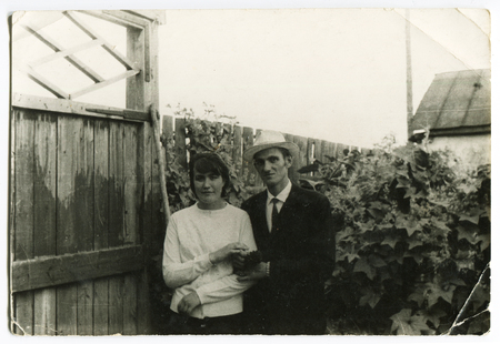Ussr - CIRCA 1970s: An antique Black & White photo show family in the yard