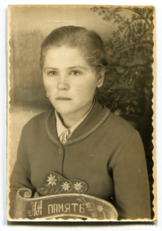 USSR - CIRCA 1960s: studio Portrait of a beautiful young woman, inscription on the photo in memory, circa 1960s