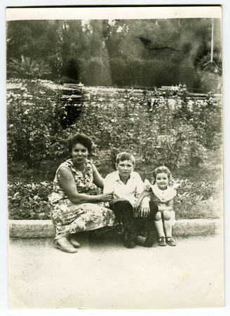 Ussr - CIRCA 1970s: An antique Black & White photo show Mother with children in city park