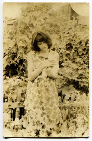 Ussr - CIRCA 1970s: An antique Black & White photo show girl in the garden