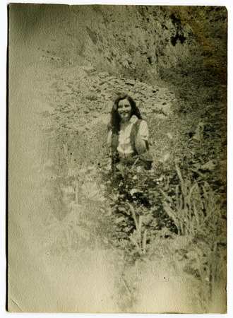 Ussr - CIRCA 1970s: An antique Black & White photo show beautiful girl outdoors in the garden 新聞圖片