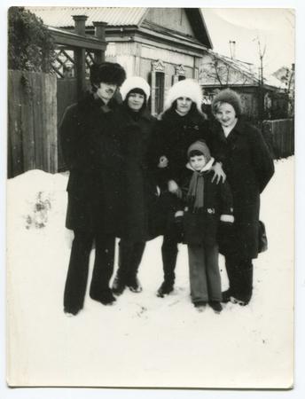 Ussr - CIRCA 1970s: An antique Black & White photo show winter family portrait