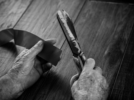 the old mans hand with scissors