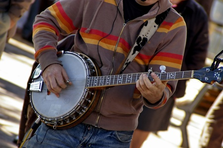 a banjo player on a street photo