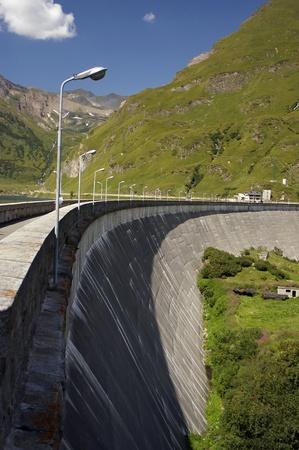dam of artificial lake on italian alps photo