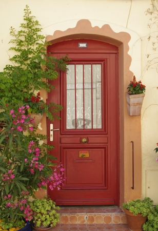 red door and flowers in Provence,France Editorial