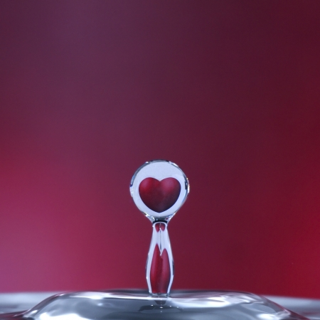 love in rain: reflection of an heart in a drop of water