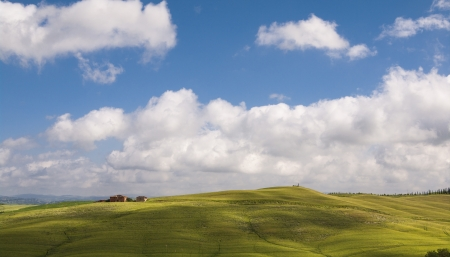 green fields and blue sky,Tuscany,Italy photo