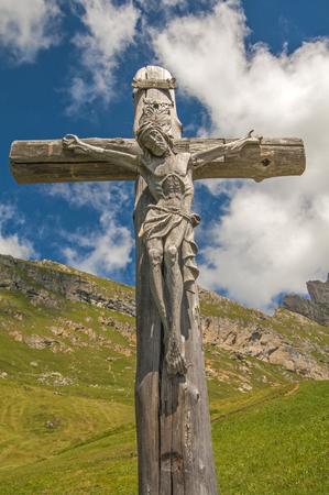 wooden cross on alps Stock Photo