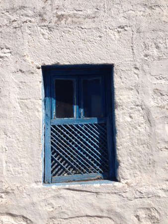 architectural: Architectural detail from traditional Aegean houses; blue painted window on a white stone exterior Stock Photo