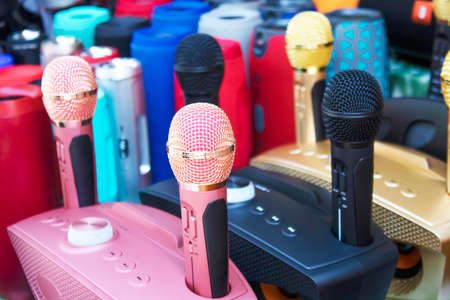 Microphone voice speaker on audio synthesiser electronic music instrument sound mixer machine in broadcasting studio room, seminar event or wedding ceremony party