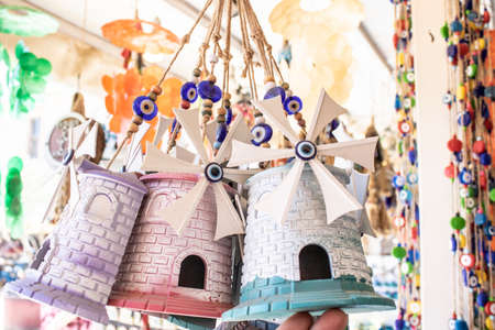 They sell small windmill as a souvenir. The island of Cunda was taken by the coast. Stok Fotoğraf
