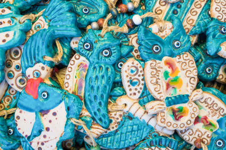 Ceramic owl figure. Blue eyes shaped evil eye beads. Banco de Imagens
