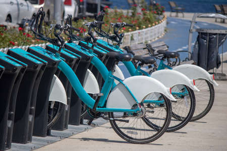 Public bikes close-up. Theyre locked in the parking lot. Banco de Imagens