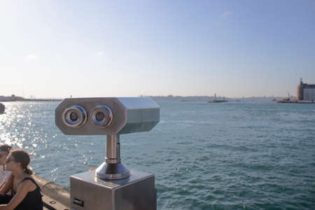 Istanbul, Turkey - September-14,2019: Binoculars on the edge of the Bosphorus. To get closer to the view. Working with coins. It was taken on the beach. Stok Fotoğraf