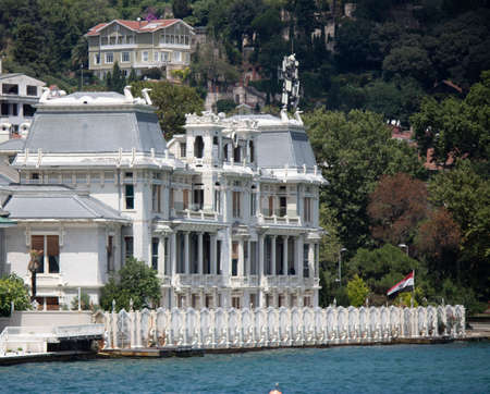 Egyptian consulate photographed over the sea. Historic building in white color