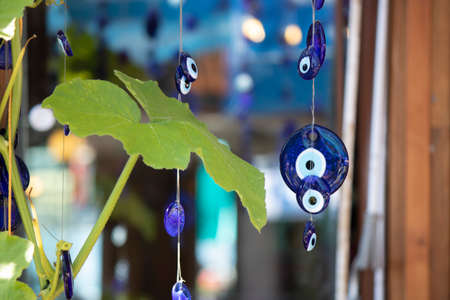Close up of evil eye beads attached to the tree.