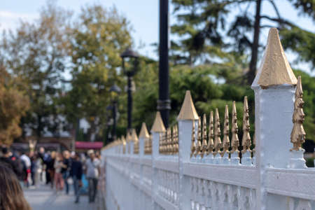 White and gold patterned fence with ottoman style patterns.