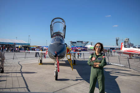 Istanbul, Turkey - September-22,2019: 5 aerobatic aircraft close-up. Front withdrew. Lady pilot poses.