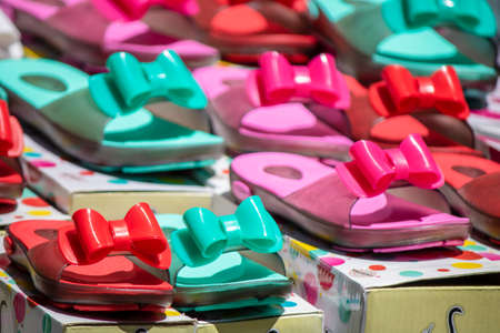 Colorful slippers with bow tie on.