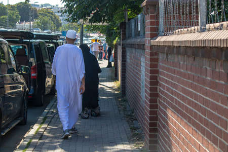 Eminonu, Istanbul, Turkey - July 29, 2019: Muslim family with local clothes walking on the road. Black and white local costumes. Editöryel