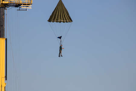 Istanbul, Turkey - September-18,2019: He is training people with a parachute attached to a crane.