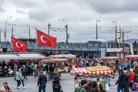 Istanbul, Turkey - October-5.2019: Eminonu Square is a very old square. It is crowded around the clock. Grilled fish are sold in historic boats.