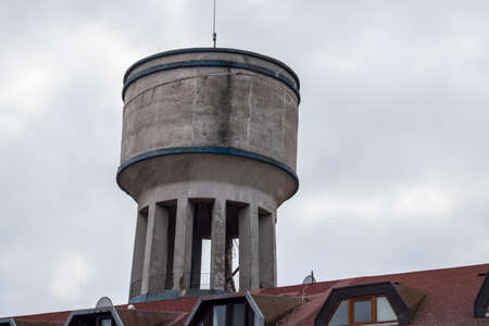 Water tower close-up. It is used where water pressure is not sufficient. Made of concrete.