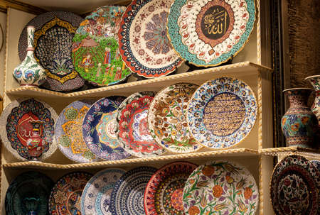 Patterned plates are sold in the store. It contains patterns of Turkish culture.