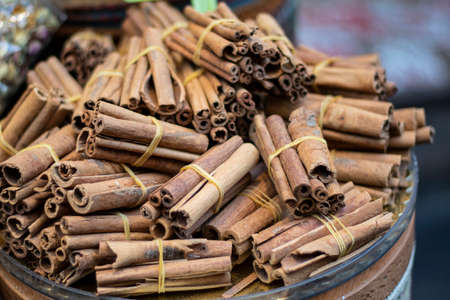 Cinnamon sticks close-up. They are wrapped with rope and sold.