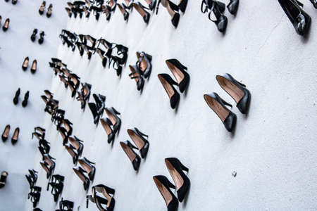 440 womens shoes were hung on the wall against the murders killed by their wives. To draw attention to murdered women. Editorial