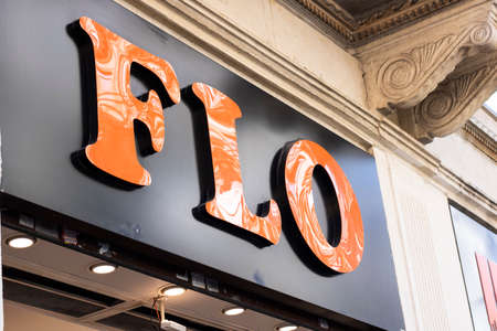 FLO a shoe store in Turkey d. FLO sign close-up. Orange and black colors