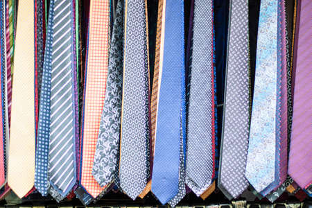 Ties in different patterns and varieties. Photographed in front of the store. Close-up.