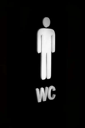 Black and white signpost for mens toilet. Close-up was taken from the edge.