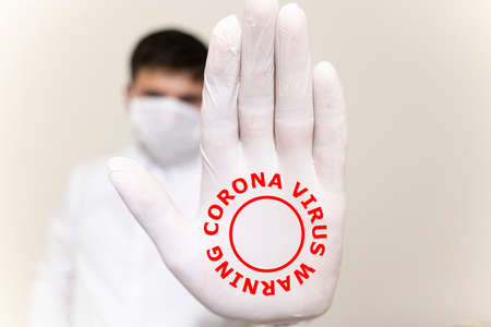 The patient was infected. Mouth mask and gloves were used. 写真素材