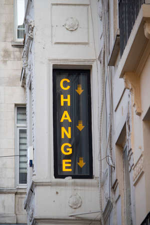 Change text written on the glass of the exchange office.