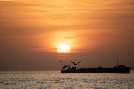 Kadikoy Moda coast sea view at sunset. Photographed outdoors.