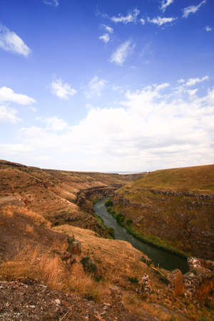 The Aras or Araxes is a river that starts in Turkey and then flows along the borders between Turkey and Armenia. Sunset