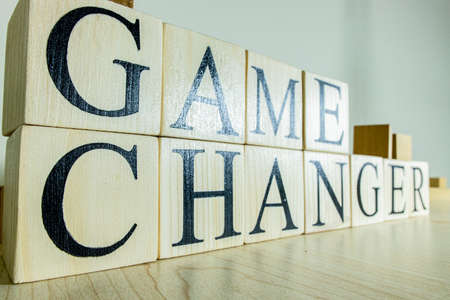 Game changer text on wooden cube blocks. Close up. Consept.