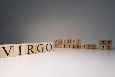 Virgo word on wooden cubes on white background. Photographed in the studio and in spot light. Zodiac or star signs consists of 12 horoscopes.