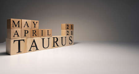 Taurus word on wooden cubes on white background. Photographed in the studio and in spot light. Zodiac or star signs consists of 12 horoscopes.