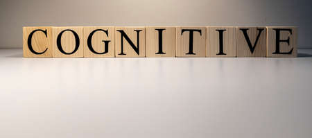 Cognitive text from wooden cubes. The term psychology profession. Close up. Foto de archivo