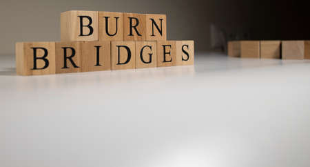 Fighting means leaving, burn bridges. Made of wooden cubes on white background.